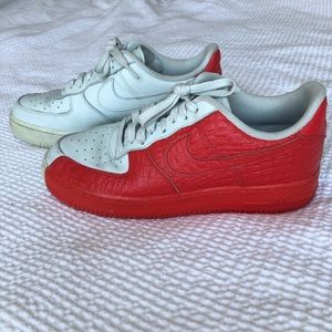 Half red snake skin, half white Air Force ones.